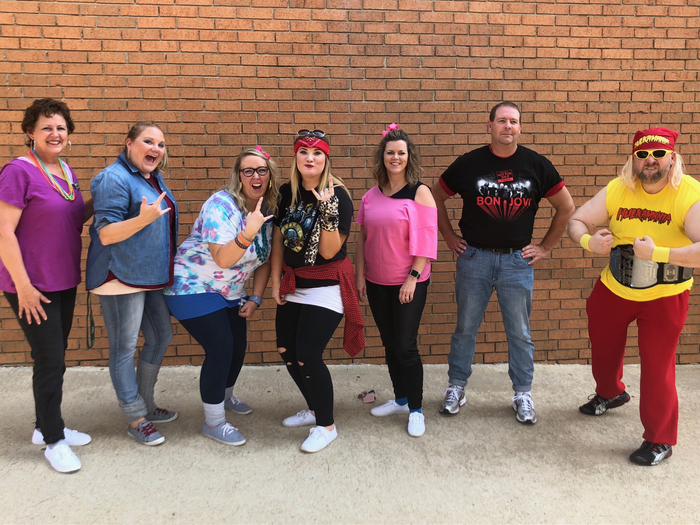 Staff dressed in 1980s theme