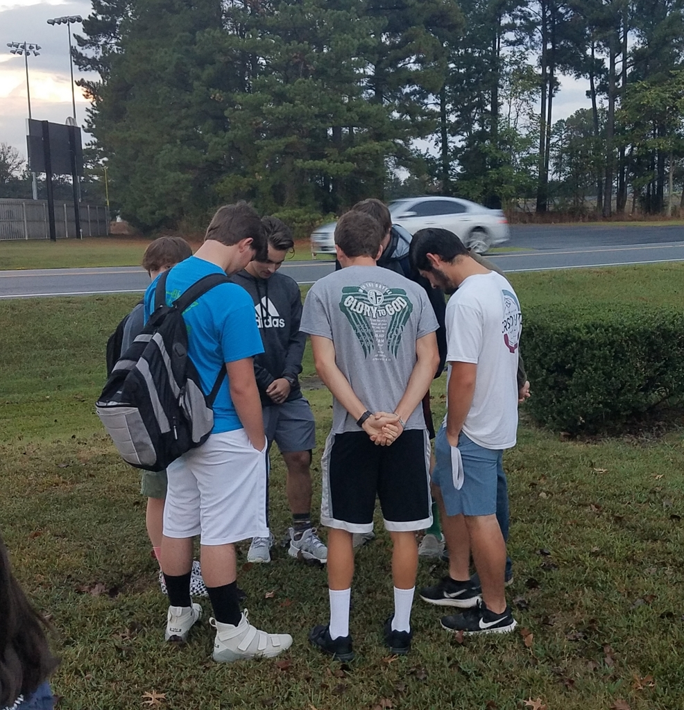 Sr High boys pray